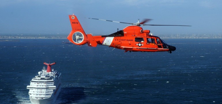 US coast guard helicopter and cruise ship