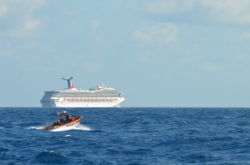 coast guard escorts cruise ship