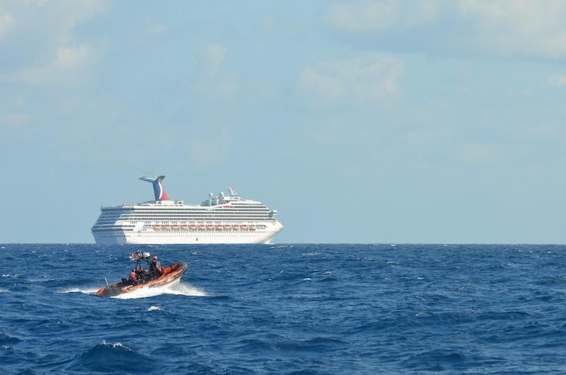 coast guard escorts cruise ship