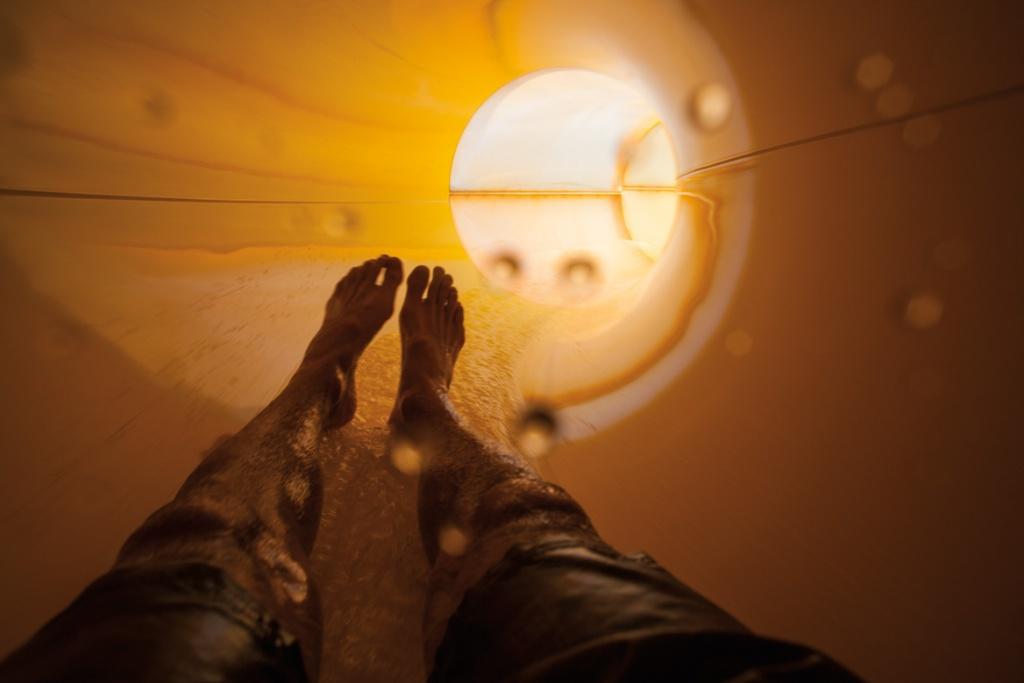 Legs in slide at WaterWorks