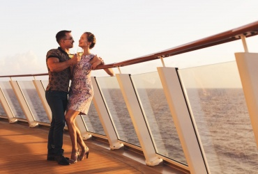 couple standing with glasses white wine on cruise ship